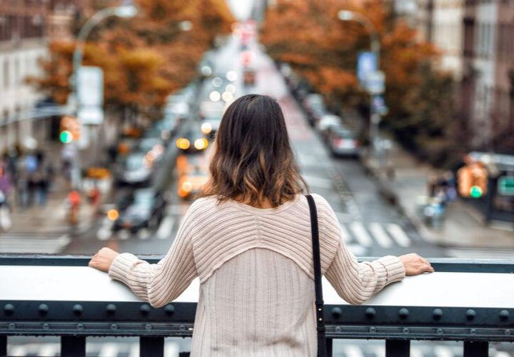 woman in sweater looking from bridge