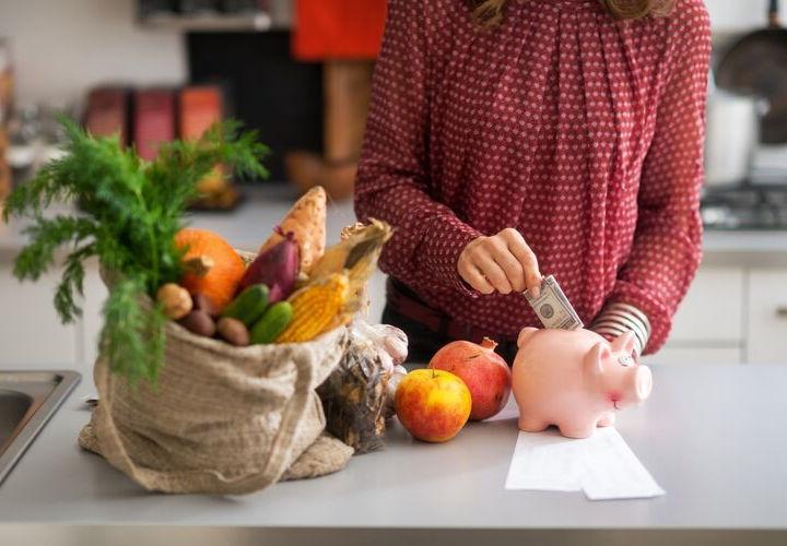 woman putting money in piggybank