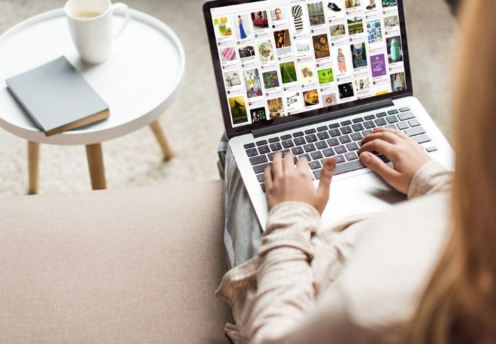 Woman using Pinterest in her laptop