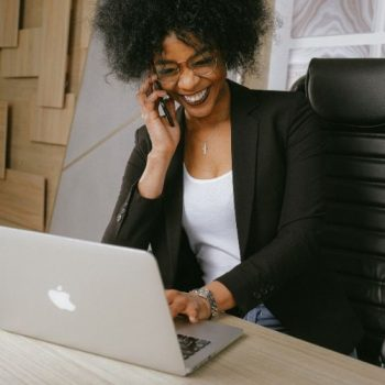 Happy black woman at work_diverse stock photos