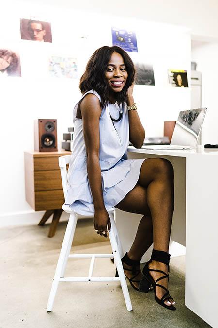 Professional beautiful black woman at desk